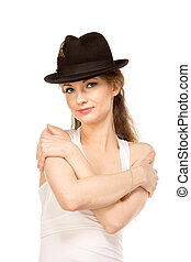 Pretty woman in hat with bird's feather