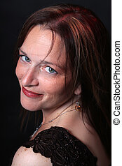 Pretty woman in her forties - Pretty close up portrait of...