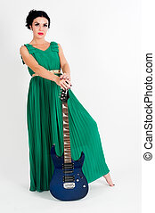 Pretty woman in long green dress with guitar
