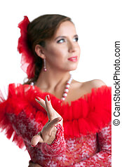 Pretty woman in red dress performing flamenco