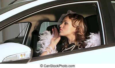 Pretty Woman In Retro Style Posing In Car