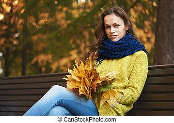 Pretty woman in the autumn park