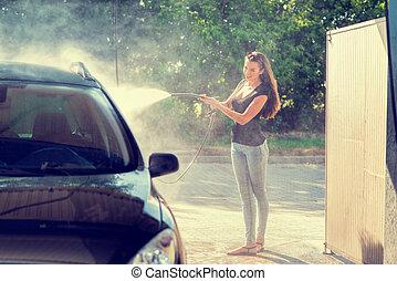 Pretty woman in the car wash - hand wash