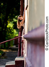 Pretty woman in the doorway of a house