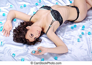pretty woman in underwear on bed