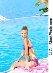 Pretty Woman in Violet Summer Wear at the Poolside