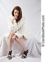 Pretty woman in white fur coat