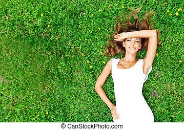 Pretty woman in white on grass