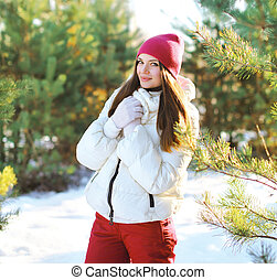 Pretty woman in winter sunny day