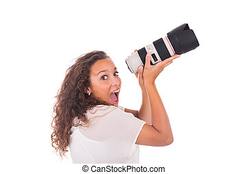 Pretty woman is a professional photographer with camera lens