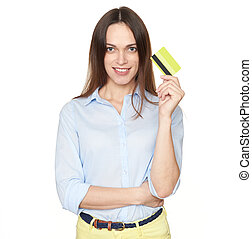Pretty woman is holding a credit card isolated on white background
