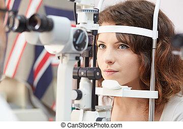Pretty woman is looking into eye te