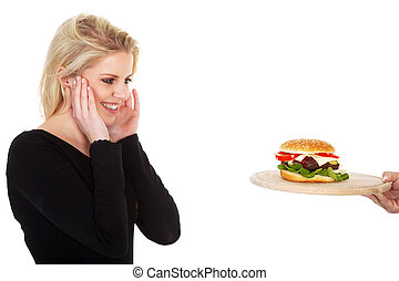 pretty woman is pleased with hamburger