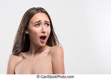 Pretty woman is very afraid of something