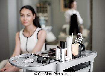 Pretty woman is visiting modern beauty salon