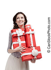 Pretty woman keeps a number of gift boxes