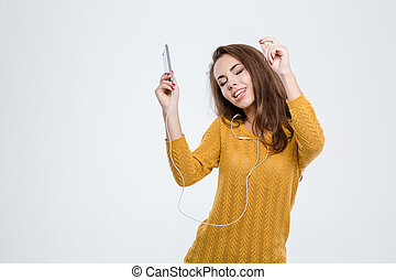 Pretty woman listening music in headphones