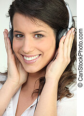 Pretty woman listening to headphones