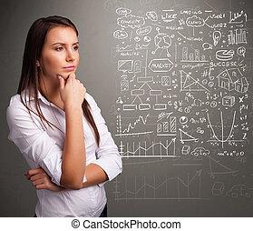 Pretty woman looking at stock market graphs and symbols -...