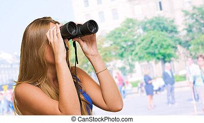 Pretty Woman Looking Through Binocular