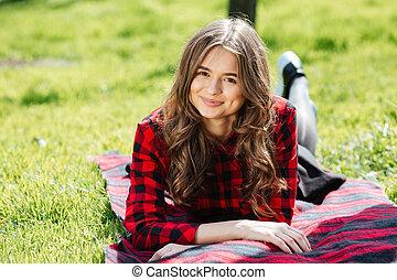 Pretty woman lying on the grass