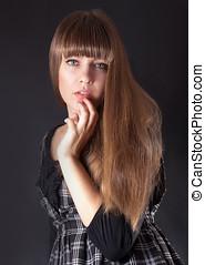 Pretty woman on a black background