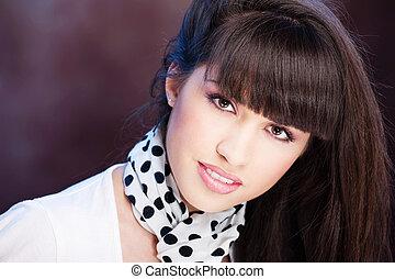 Pretty woman on dark background