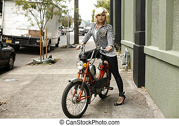 Pretty woman on moped - Pretty woman on a moped.