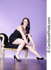 pretty woman on stool