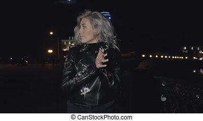 Pretty woman on street at night