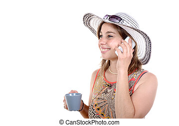 pretty woman on the phone with a cup of tea