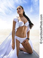 pretty woman on the sea shore