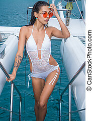 Pretty woman on the yacht - Young brunette woman in white...