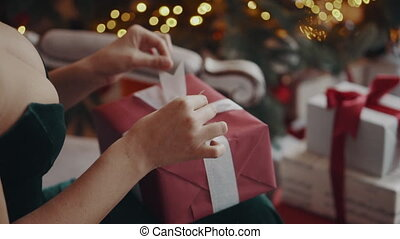 pretty woman opening gift box at night