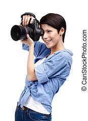 Pretty woman-photographer takes snapshots
