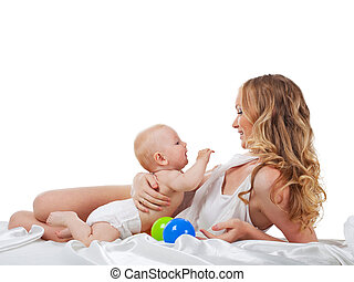 Pretty woman play with son in bed isolated