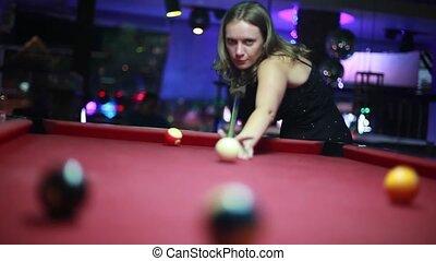 Pretty woman playing pool in a night bar. 1920x1080, hd