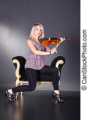 Pretty woman playing violin