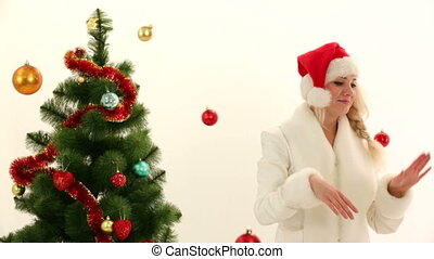 Pretty Woman Playing With Christmas Decorations