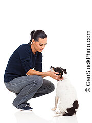 pretty woman playing with her dog