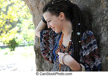 Pretty woman portrait with dreadlocks