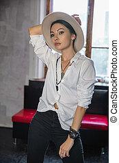 Pretty woman posing in studio