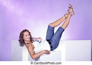 pretty woman posing on cube
