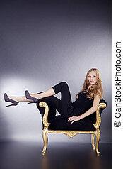 pretty woman posing on stool