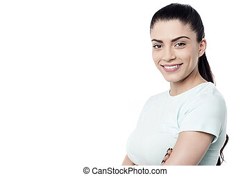 Pretty woman posing with folded arms