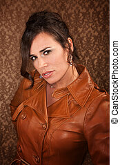 Pretty Woman - Pretty woman in leather coat on gold...