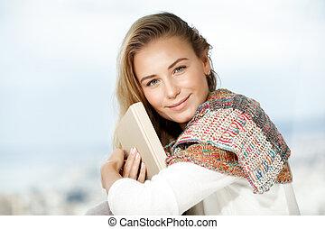 Pretty woman reads a book