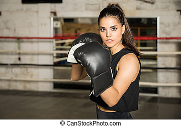 Pretty woman ready to box