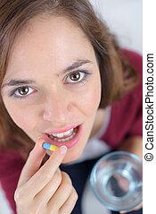 pretty woman ready to swallow pill