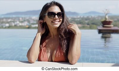 Pretty woman refreshing in pool in hot day - Attractive ...